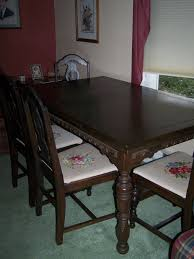 circa 1940 mahogany dining table with 4 chipendale style cross