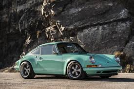 this mouthwatering custom porsche stuns in seafoam green airows