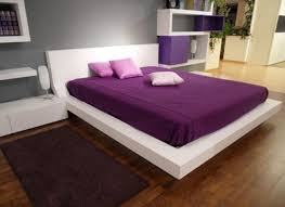 charming purple bed cover with white bed and headboard wooden