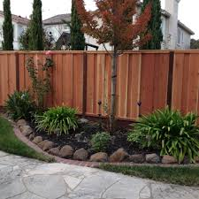 4ft to 3ft step down redwood fence board on board with trellis yelp