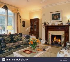 traditional wood paneled british drawing room interior stock photo