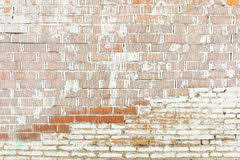 old red brick wall with white paint background texture stock photo