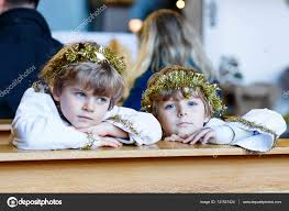 two little boys as angels of christmas story eve in church u2014 stock
