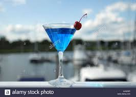martini cosmopolitan a fancy blue cosmopolitan drink in a martini glass with cherry