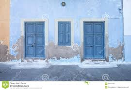 mediterranean style exterior blue wooden doors stock photo