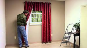 how far up from window trim should you hang curtain brackets