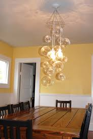 lighting floating bubble chandelier with yellow paint wall and