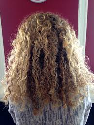 pale highlights frame face this short curly hairstyle