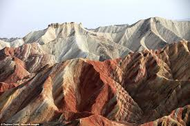 Spectacular pictures show the incredible      rainbow hills      in China     Amazing red colours  The colours of the rocks are due to red sandstone and mineral