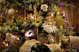 decoration on the christmas tree composition with dolls roses