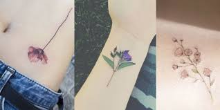 14 delicate flower tattoos flower tattoo ideas u0026 inspiration