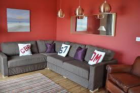 modern living room designs with red wall color and corner sofa