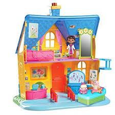 doc mcstuffins playhouse amazon com doc mcstuffins clinic doll house with doll toys games