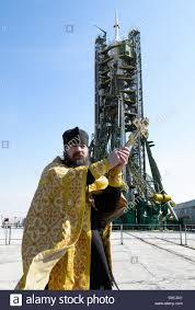 a russian orthodox priest blesses the soyuz tma 12m spacecraft on