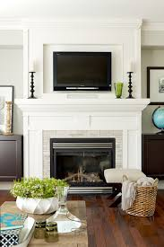where to place tv in living room with fireplace hanging your tv over the fireplace yea or nay driven by decor