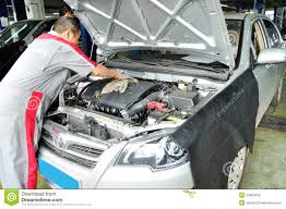 motor cars toyota worker cleaning the car engine editorial image image 34562650