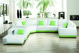 modern living room design with corner green leather sofa and art