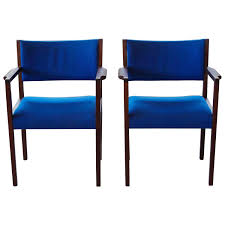 pair of cobalt blue jens risom dining side chairs with arms