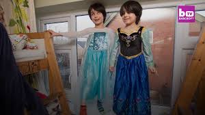 our twin boys five love wearing princess dresses and playing