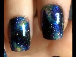 glossy galaxy nail art design