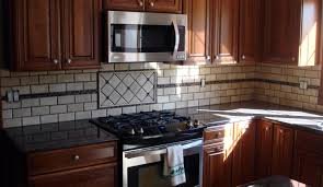 interior brown wooden kitchen cabinet with beige tiled back