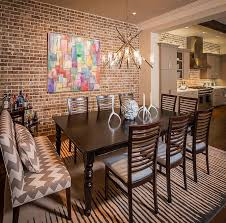 50 modern wall art ideas for a moment of creativity brick wall offers a lovely backdrop for the colorful wall art piece design jamestown