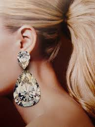 big diamond earrings now that is a statement i dont which i want to categorize this