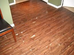 installing vinyl wood grain plank flooring after remodel living