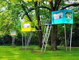 baumraum s tiny tree cubes are colorful retreats set high in the