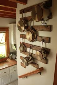 hanging pots and pans nice way to protect the wall from the pots
