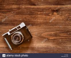 Wooden Table Top View Top View Image Of Vintage Old Camera On Wooden Table Background