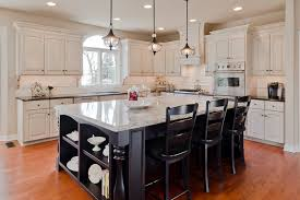 Classic Kitchen Designs Kitchen Table And Black Chairs And A Chandelier In The Kitchen