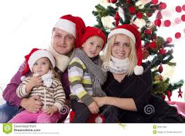 family with two children in santa hats stock photo image 35057090