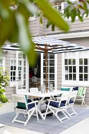 Blue And White Striped Patio Umbrella Black And White Striped Outdoor Patio Umbrella Design Ideas