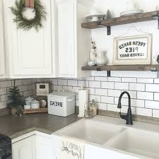 white kitchen with copper farmhouse sink