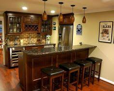 basement kitchen bar ideas like the wood bar top and colour of cabinets and also floor is
