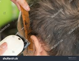 usinghair cls barber girl using hair clipper making stock photo 780886753