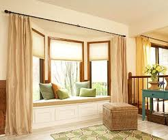 bay window with roller shades for the windows as well as long