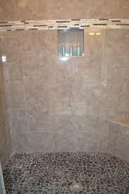 master bath shower floor river rock tile vision pointe homes