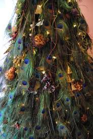single peacock feather ornament with and by hillsdesign