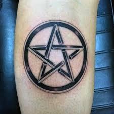pentagram star tattoo on side leg