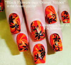 black flowers over orange stripes design nail art nails