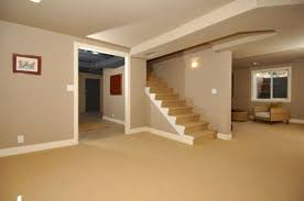 transitional basement with light tan carpeted stairs designmine