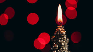 light up christmas candles christmas candle burning on a bokeh background close up video