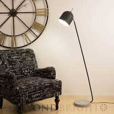 huge calder style floor lamp in black with a concrete base