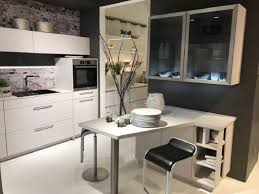 White Kitchen Cabinets With Glass Doors Glass Kitchen Cabinets White Cabinets And Counter Black Leather