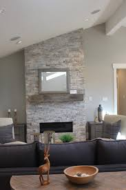 Gas Fireplace Mantle by Stacked Ledger Stone Gas Fireplace With Reclaimed Barn Beam Mantel