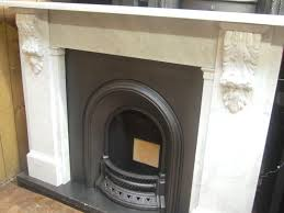 white marble feat dark brown fireplace mantle surround attached on
