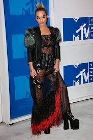 rita ora flashes bra u0026 underwear in sheer black feather dress at