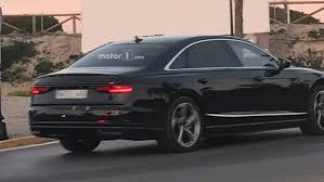 2018 audi a8 drops some camouflage in new spy photos